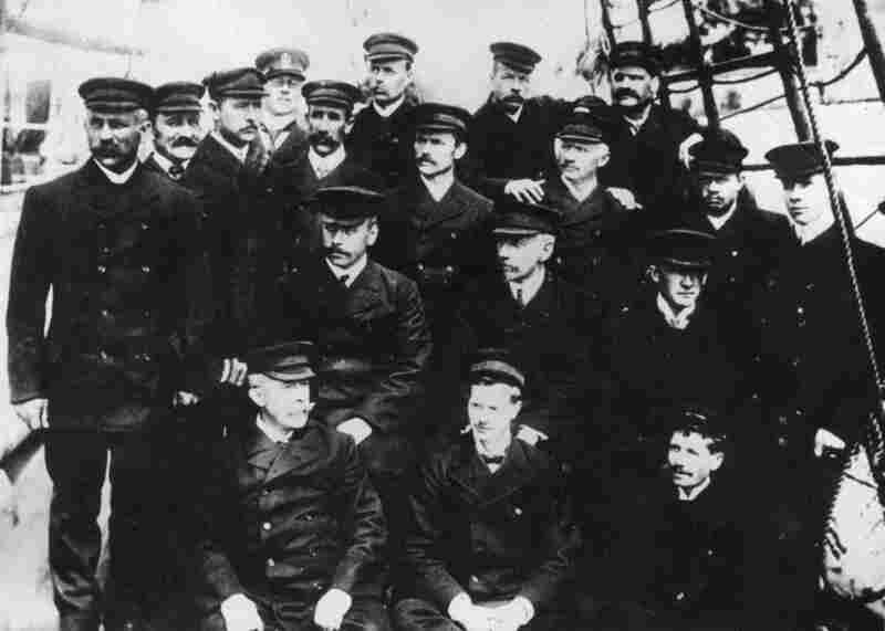Norwegian explorer Roald Amundsen, the first to reach the South Pole, poses with members of his Antarctic expedition team in 1911. Amundsen reached the South Pole in December 1911 with a small team and a pack of sled dogs.