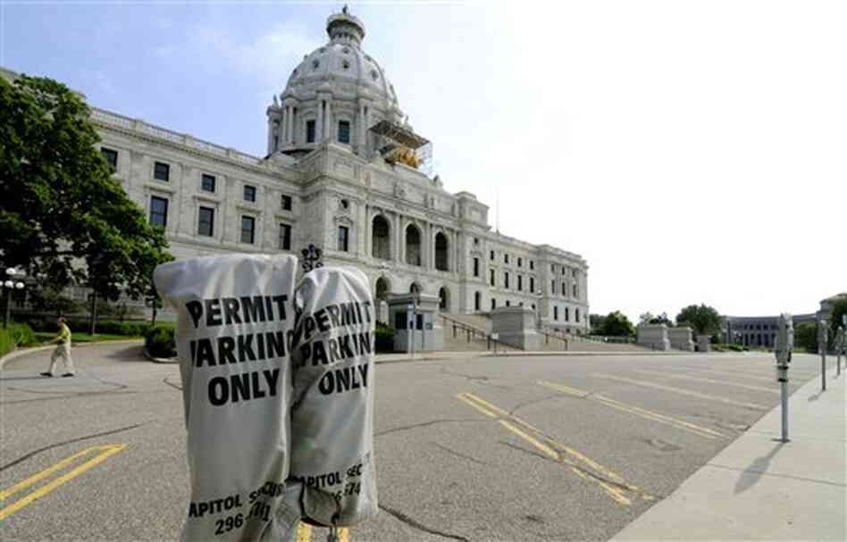 Lawmakers' parking spots were empty in front of the Minnesota State Capitol in St. Paul Friday.