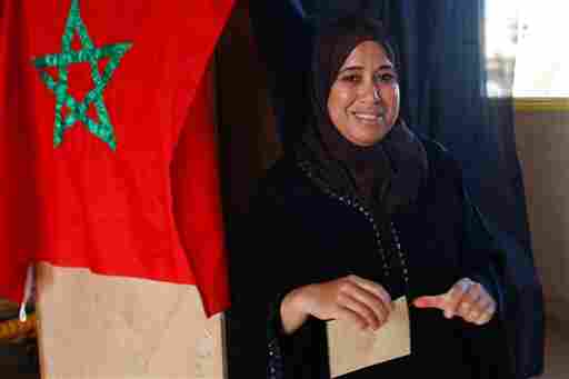 A Moroccan woman leaves a polling booth as she casts her vote on a new constitution in Rabat, Morocco, Friday. The vote was seen as an indicator of the public's faith in the reform process of 47-year-old King Mohammed VI.