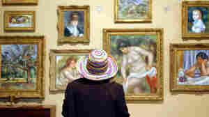 A visitor looks at paintings at the Barnes Foundation in Lower Merion, Pa. The art collection is moving to a new building in downtown Philadelphia.