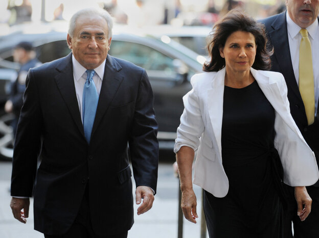 Former IMF head Dominique Strauss-Kahn and his wife Anne Sinclair as they arrived for today's court hearing in New York City.