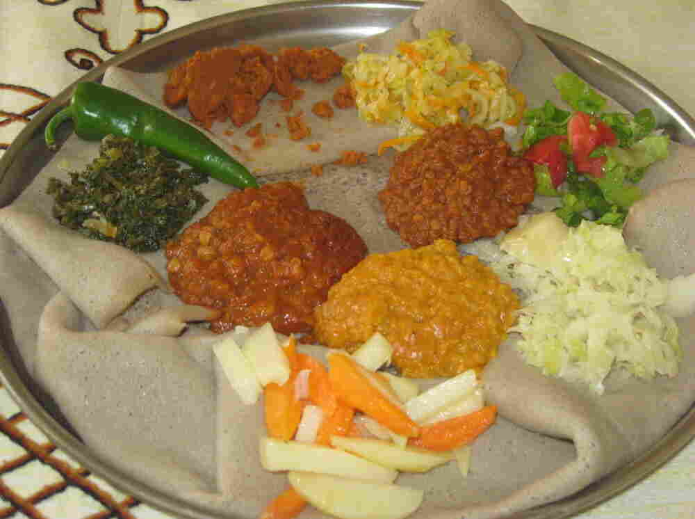 A traditional Ethiopian meal on a platter, part of Tinbete Ermyas's Fourth of July dinner.