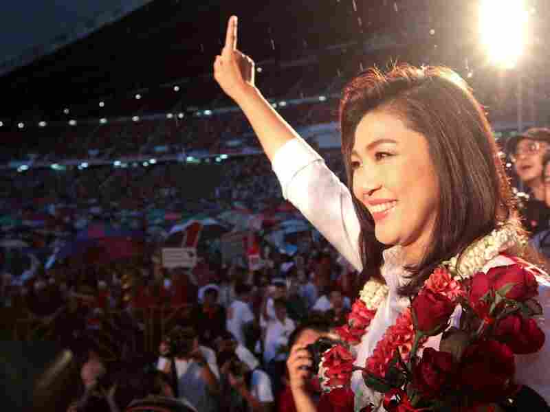 Yingluck gestures to her supporters during an election campaign at Rajamangala stadium in Bangkok on Friday.