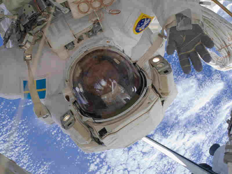 Mission Specialist Christer Fuglesang waves on a spacewalk during a 2009 shuttle visit to the International Space Station.