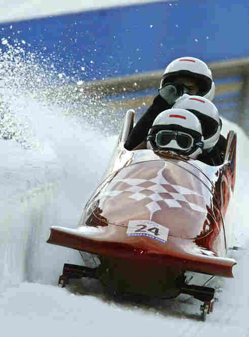Albert pilots the sled during the four-man bobsled event at the Salt Lake City Olympics.