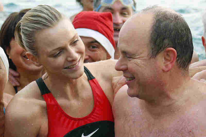 Albert and Wittstock, a South African Olympic swimmer, finish swimming in the Mediterranean for a Christmas fundraiser in December 2009 in Monaco. The pair, who began dating four years ago, are often seen at sporting events together.