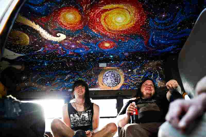 Guitarist Garrett Underwood (left) and drummer Joshy Brettell from the D.C. death-doom metal band Ilsa chill in their van before heading into St. Stephen's for their evening performance.