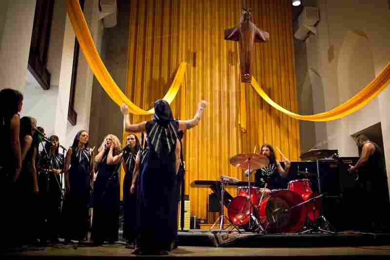 Chrissy Wolpert leads the Assembly of Light Choir, a rotating cast of 20 female vocalists, as it performs with The Body, a doom-metal band, on June 24 at St.Stephen's Episcopal church in Washington, D.C.