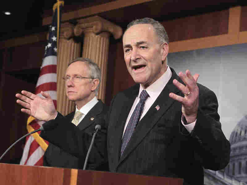 As debt talks stalled this week, Sen. Chuck Schumer (D-NY) accused Republicans of wanting the economy to fail. At left is Senate Majority Leader Harry Reid.