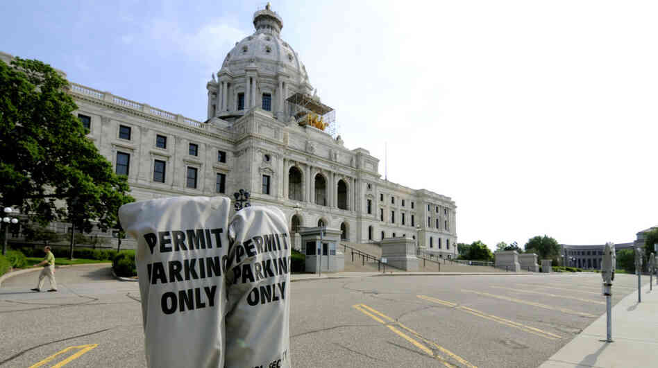 Lawmakers' parking spots were empty in front of the Minnesota Capitol in St. Paul on Friday.