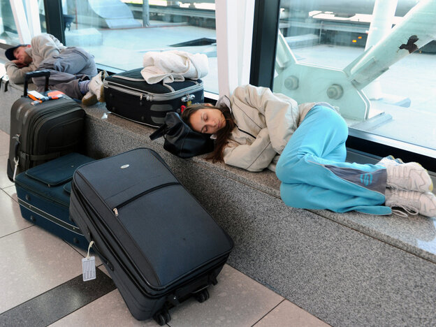 Passengers take a nap at Ezeiza airport in Buenos Aires, after domestic and international flights in two airports after volcanic eruptions in Chile.