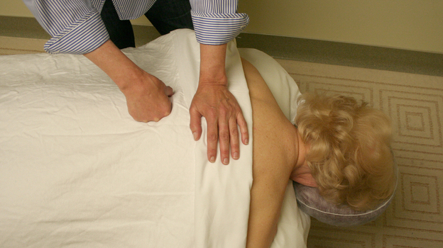 Peggy O'Brien-Murphy receives a massage from therapist Loretta Lanz. O'Brien-Murphy was among the participants in a study that found both relaxation and deep tissue massage are effective treatments for lower back pain.