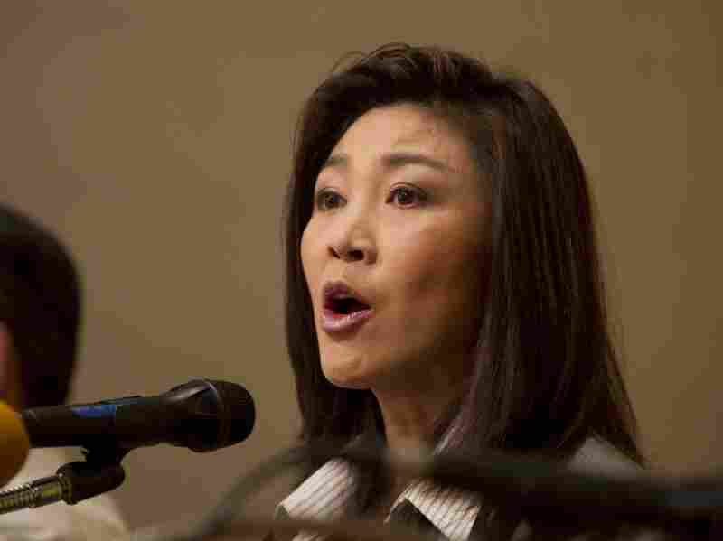 Yingluck  Shinawatra speaks to the media the  day after her party won an overwhelming victory in Sunday's national  election. The party  is loyal to Yingluck's brother former Prime Minister Thaksin  Shinawatra.
