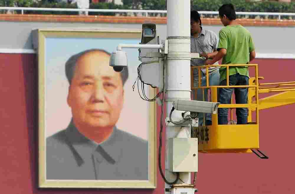Chinese laborers adjust a surveillance camera at Tiananmen Square in 2007 in Beijing, China.