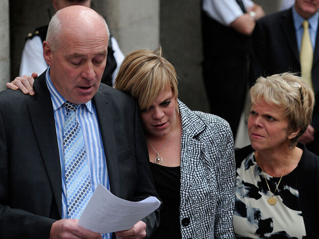 Bob Dowler, father of murdered schoolgirl Amanda (Milly) Dowler, reads a statement outside the  Old Bailey in central London on June 24. With him are Milly's mother, Sally (right), and sister, Gemma.