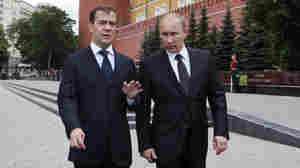 President Dmitry Medvedev (left) and Prime Minister Vladimir Putin walk after a wreath-laying ceremony at the Tomb of the Unknown Soldier outside Moscow's Kremlin Wall.