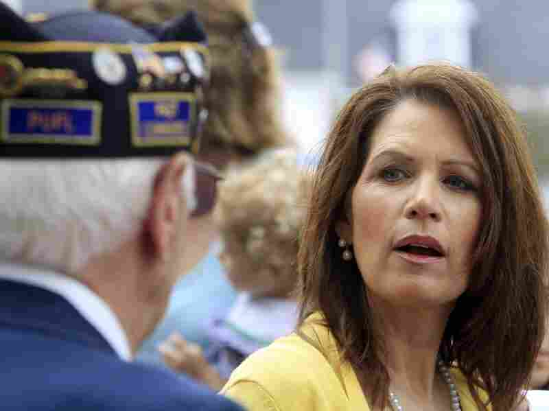 Meet And Greet: Rep. Michele Bachmann talks with veterans after marching in a Memorial Day parade in North Hampton, N.H.