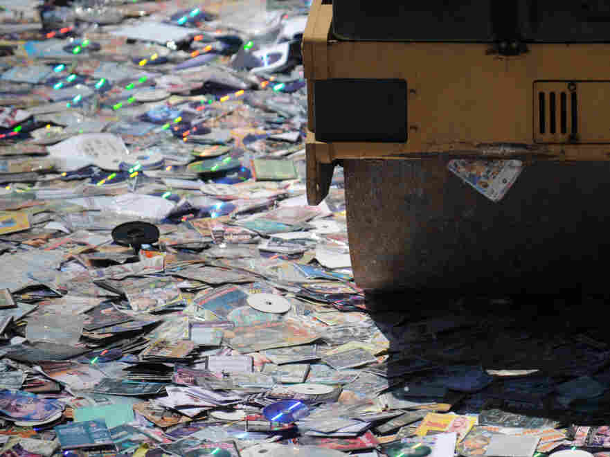 It's very tempting ... CDs (albeit pirated ones) being crushed by a steamroller in Colombia.