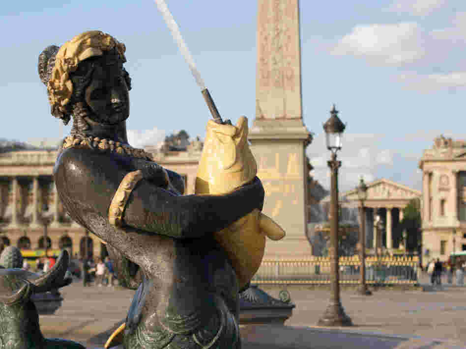 Mermaid sculpture in a fountain at Place de la Concorde in Paris.