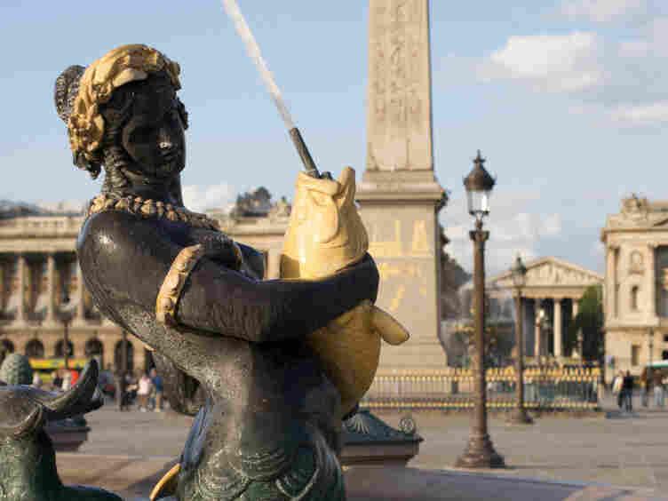 Mermaid sculpture in a fountain at Place de la Concorde in Paris.