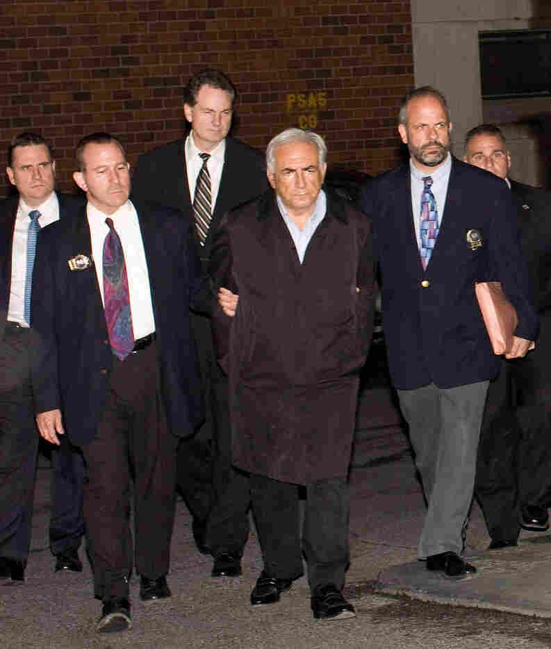 The power of an image: Dominique Strauss-Kahn hardly looks innocent as New York police escort him in handcuffs to a police vehicle on May 15, 2011.