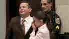 Defense attorney Jose Baez and Casey Anthony hug after the jury acquitted her of murdering her daughter, Caylee, during the trial at the Orange County Courthouse in Orlando, Fla., July 5, 2011.