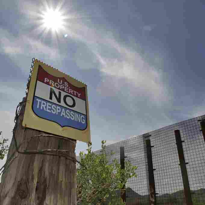 A no trespassing sign is shown at the International border Monday, Aug. 16, 2010 near Naco, Arizona.
