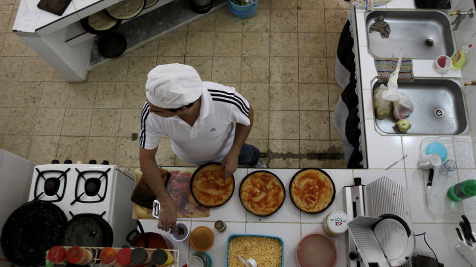 Julio Cesar Hidalgo prepares pizza in the restaurant run out of his home in Havana. The  Cuban government has given out more than 300,000 new self-employment  licenses in the past eight months. (AP)