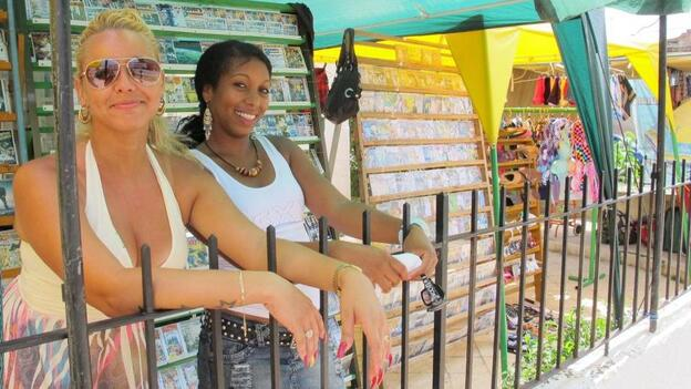 Ivelis Ramos (right) was laid off from her state job as a bookkeeper last year and now runs a makeshift store in Havana's Miramar neighborhood. Restrictions on privately owned businesses are beginning to relax under Raul Castro, Fidel Castro's brother. (Nick Miroff for NPR)