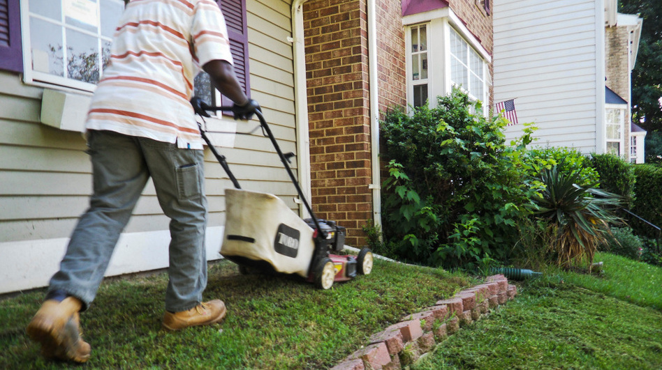 A lawn maintenance worker mows the lawn of a foreclosed  Lanham, Md., home. Fannie Mae spends tens of millions of dollars a year just on lawn maintenance  for the more than 150,000 foreclosed properties on its  books.