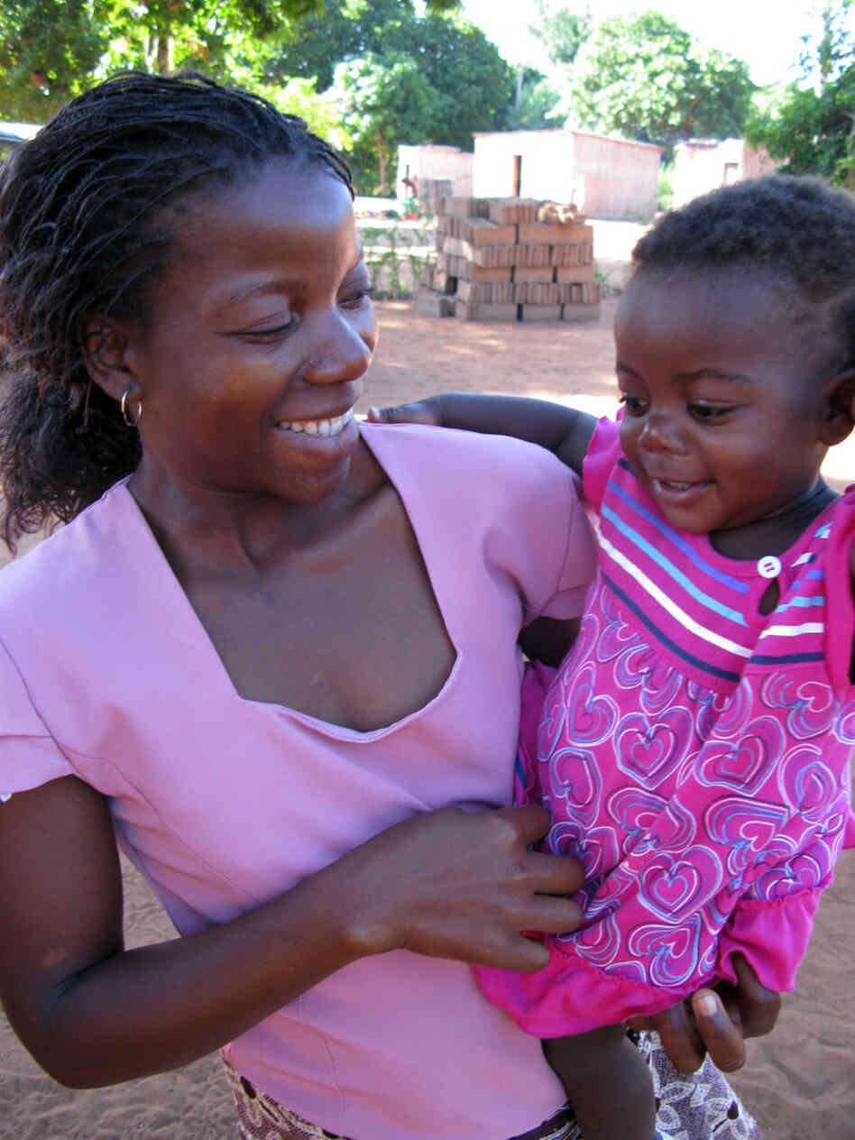 While the majority of women in  Mozambique breast-feed their children,  Acacia Mukambe, who is HIV-positive, chose not to. Her daughter Virginia is now