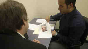 Using revamped photo lineup procedures,  a Dallas police officer shows a victim of a robbery a single photo of a suspect in an interview room at police headquarters in 2009. Dallas  officially adopted lineup reforms two years ago, and last month the state of Texas said all police departments must review lineup procedures.