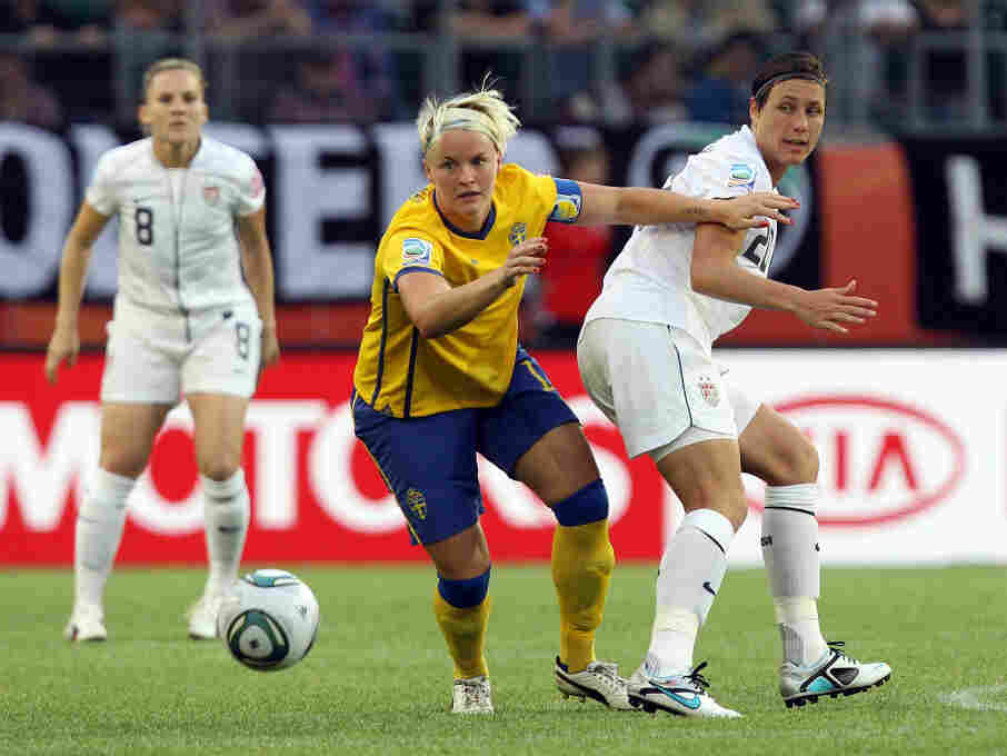 Nilla Fischer of Sweden and America's Abby Wambach battle for the ball during their Group C match in the Women's World Cup. Sweden took an early 1-0 advantage in the match.