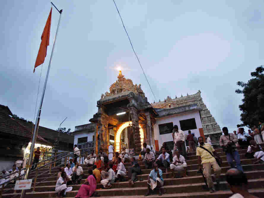 Visitors rested Tuesday (July 5, 2011) on the steps outside the 16th-century Sree Padmanabhaswamy Temple in Trivandrum, India. Inside, billions of dollars worth of treasure have been discovered.