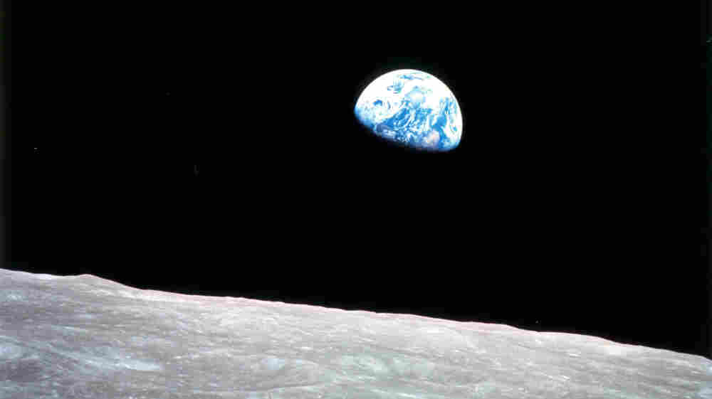 While orbiting the moon, Apollo 8 astronauts were greeted by this view of the rising earth.