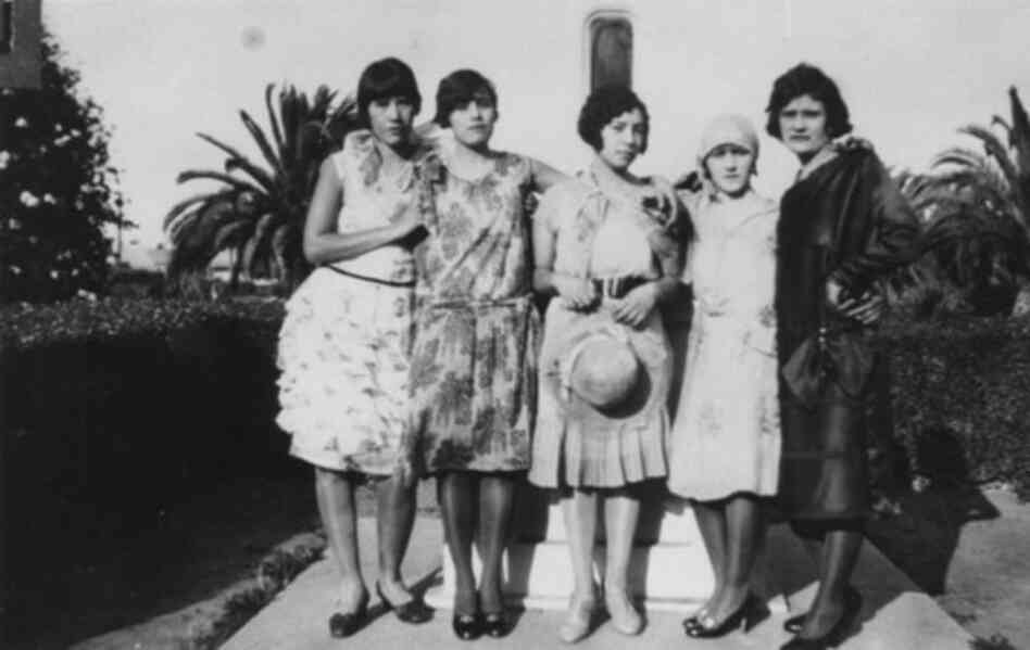 A group of Mexican-American flappers stand in a Southern California park in 1925.