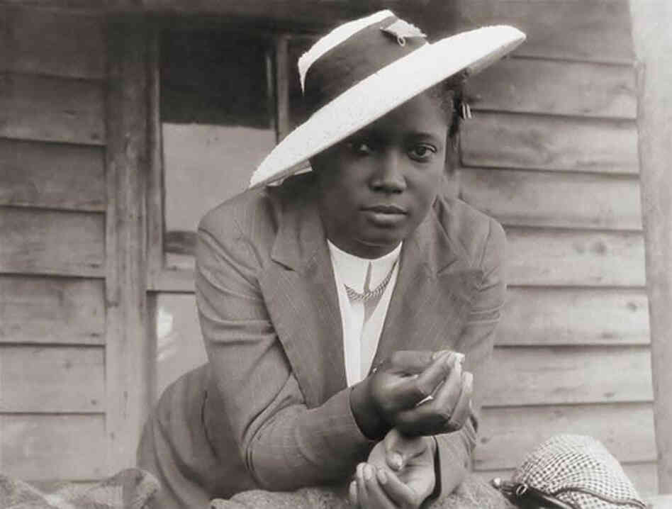 "A North Carolina woman waits for a ride to church. ""The date of the photograph is 1940, but the tilt of that hat is forever,"" blog curator Minh-Ha T. Pham writes."