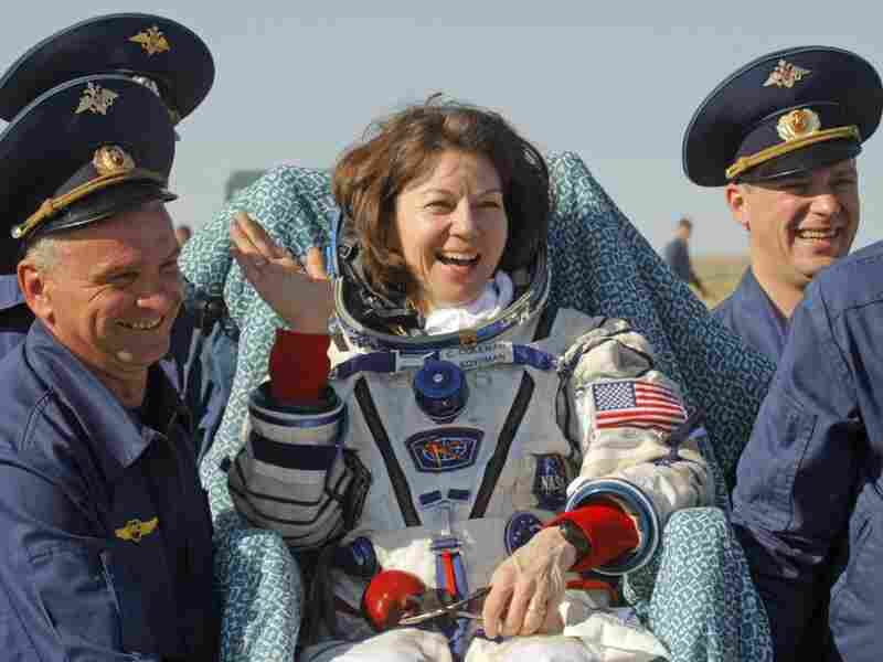 Russian space agency rescue team members carry U.S. astronaut Cady Coleman after her space capsule landed in Kazakhstan in May 2011.