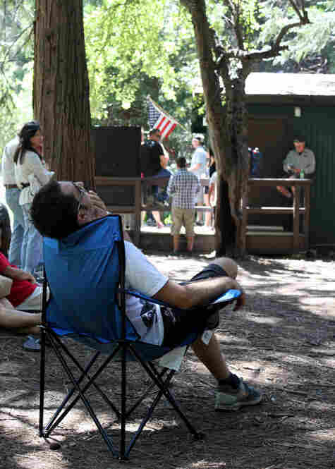 Visitors wait outside the campground office in Yosemite Valley, hoping to get a campsite off of a waiting list.
