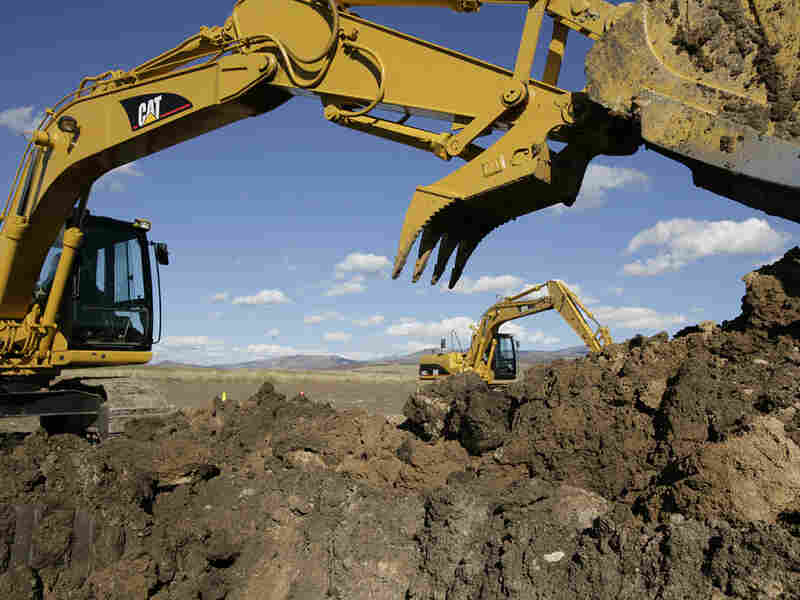 A Caterpillar Excavator at Dig This, a playground for adults that allows them to drive and operate construction equipment.