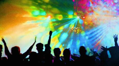 This is a photo tagged rave, club scene, light show and dance, circa 1990.