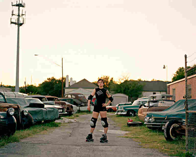 """Brit At Roller Derby Practice, Austin, Texas, 2009: We had a great time working with Brit, who was determined to articulate her definition of the undefinable word """"queer.""""  Filming for hours in her apartment, we lost track of the time, made her super late for derby practice, arriving just before the sun set!"""