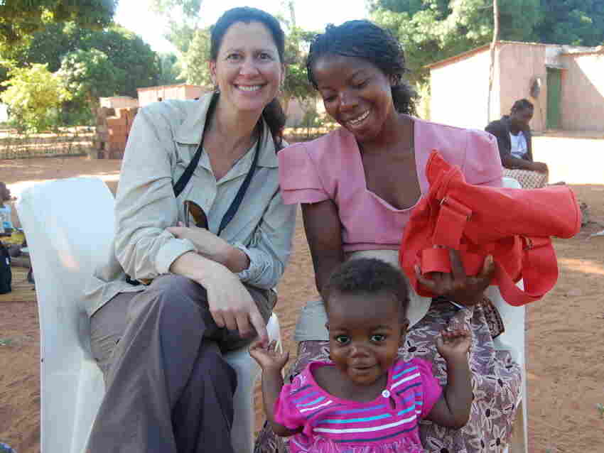 "Reporting for the ""Beginnings"" series in Mozambique, Melissa Block (l) meets Acacia Navete Mukambe and her daughter Virginia."