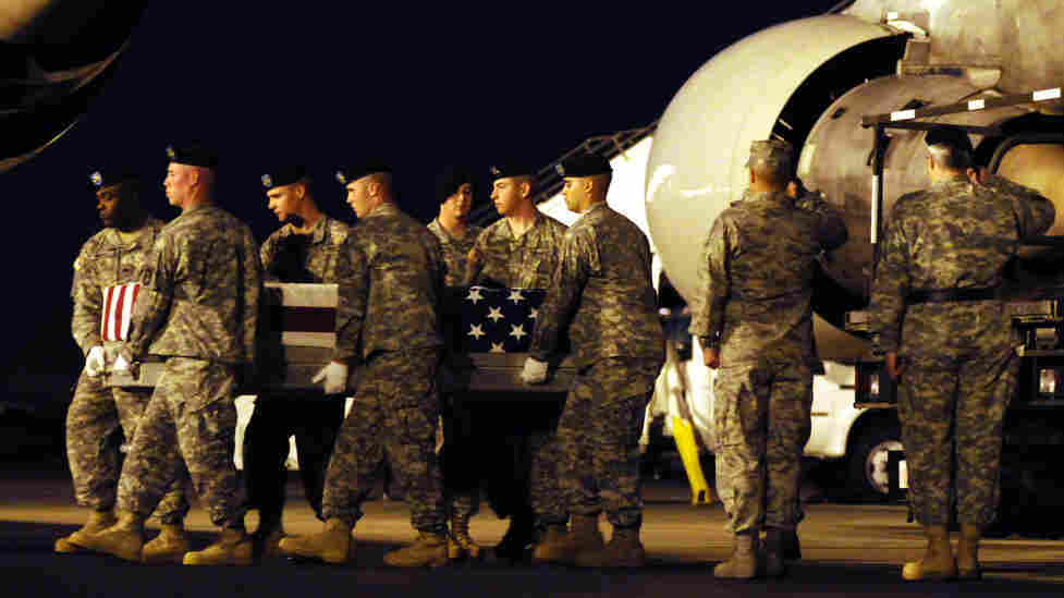An Army team carries a transfer case containing the remains of Army Pvt. Keiffer P. Wilhelm at Dover Air Force Base, Del., in 2009. The Ohio soldier committed suicide in Iraq after allegedly being harassed by other men in his platoon.