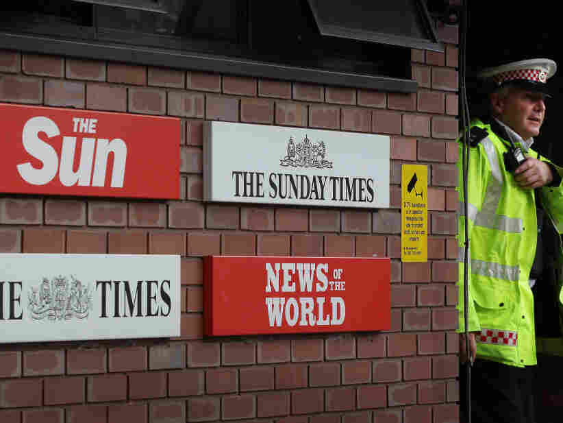 A policeman walks through the security gates at News International's wrapping plant on July 7 in London.