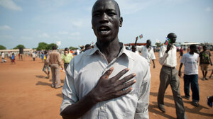 A South Sudanese man sings the new national anthem. In the recording below, students at Juba Commercial Secondary  School perform the song.