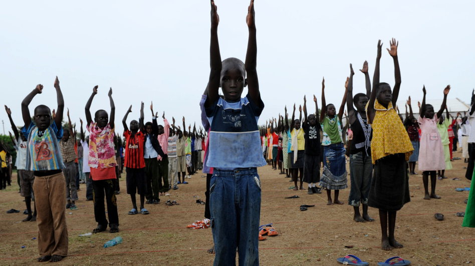 A handout picture released by the United Nations Mission in Sudan shows South Sudanese children rehearsing their dance routine to be performed at half time during a football match as part of independence day celebrations in Juba on Thursday, two days before South Sudan secedes from the north and becomes the world's newest nation.