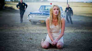 Warding Off Spirits: Kristen (Amber Heard) is committed to a women's asylum after setting fire to an abandoned farmhouse. The true nature of her past and of