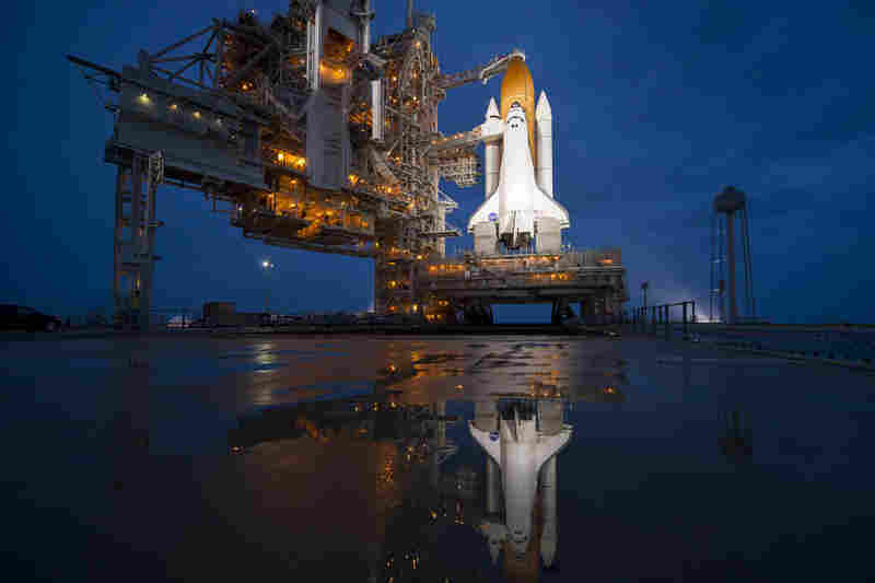 The night before the launch, Atlantis stands ready and waiting at Launchpad 39A at the Kennedy Space Center.