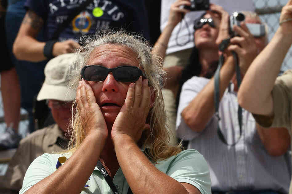 Kennedy Space Center employee Lisa Gorichky cries as Atlantis lifts off. The final flight of the shuttle program, which began in 1981, stirred emotions for many.